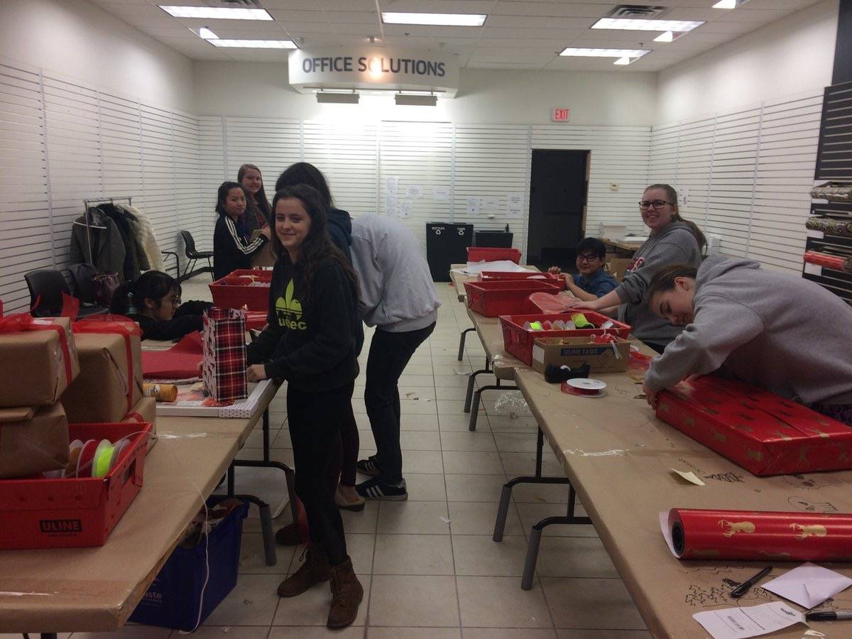 Students and others volunteered to wrap gifts at Willowbrook Shopping Centre during the holidays. The proceeds go to the Langley School District Foundation. (Submitted)