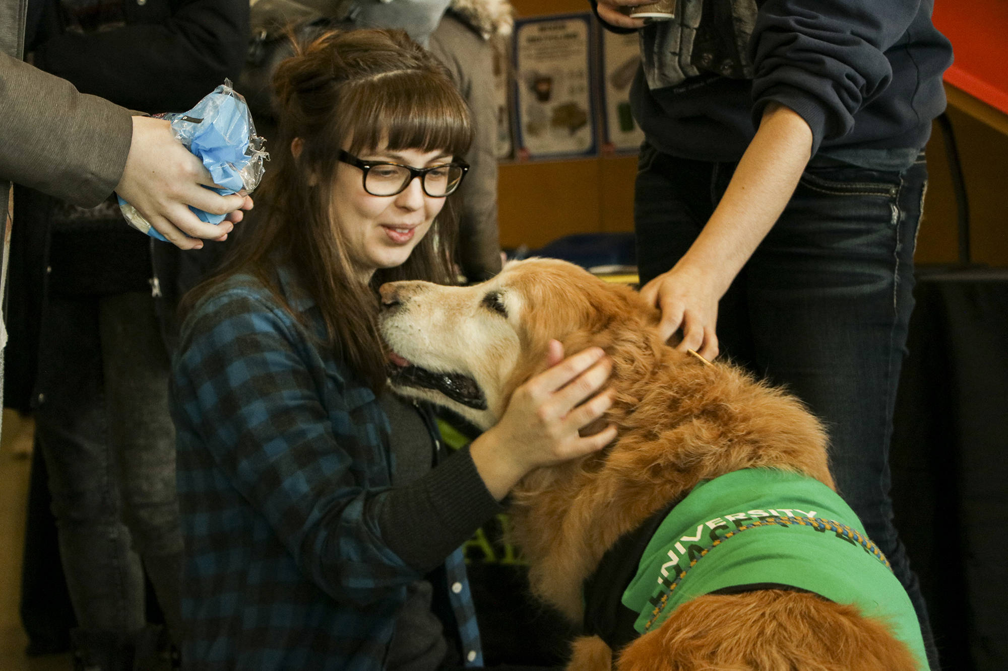Mac was a pup-ular dog at the University of the Fraser Valley sports building Tuesday afternoon, where he celebrated his 15th birthday and his retirement as a therapy dog at the University of the Fraser Valley. Dustin Godfrey/Abbotsford News
