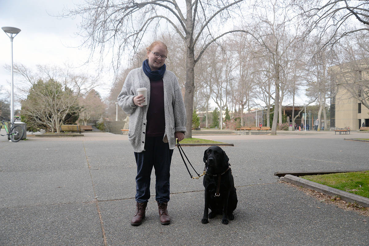 Georgia Pike and service dog Grainger live on campus at the University of Victoria. Things go smoothly at school, but when the pair head off campus Pike is constantly asked for ID. (Nina Grossman/News Staff)