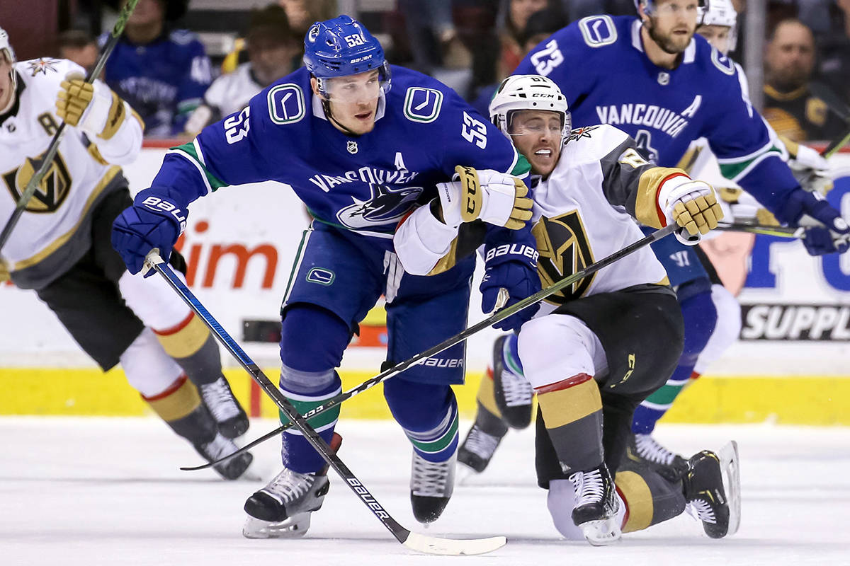 Vegas Golden Knights' Jonathan Marchessault (81) fights for the puck with Vancouver Canucks' Bo Horvat (53) during first period NHL hockey action in Vancouver on Saturday, March 9, 2019. THE CANADIAN PRESS/Ben Nelms