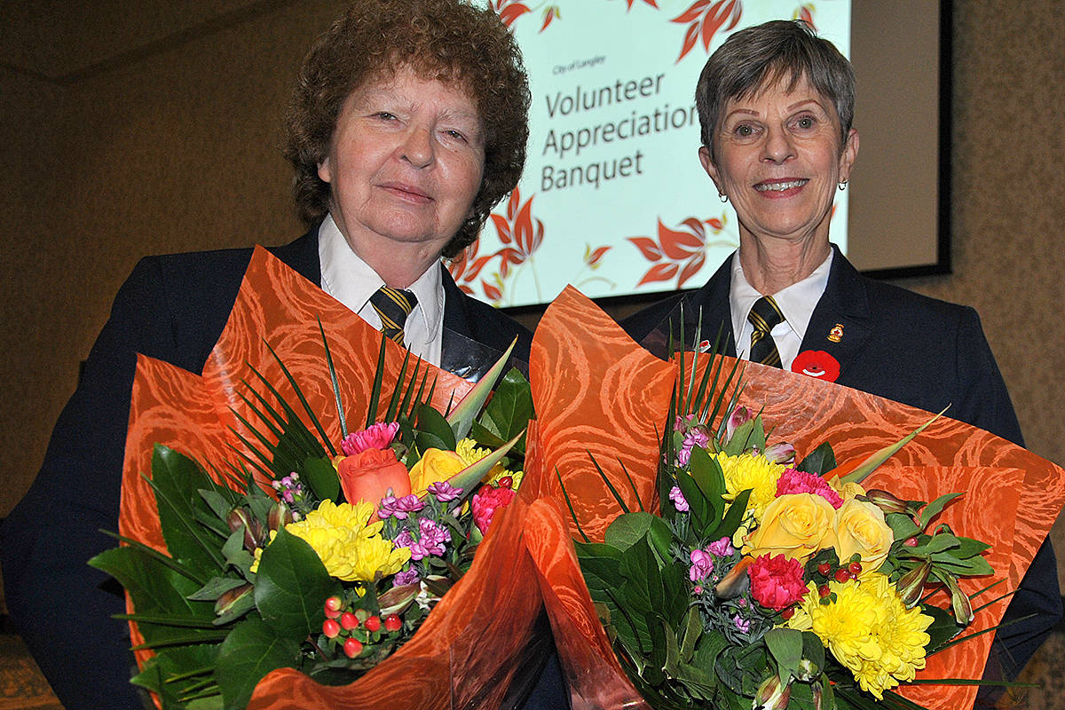 Wilma McEwen and Christine Humphrey from the Royal Canadian Legion, along with Langley Community Music School principal Carolyn Granholm and principal emeritus Susan Magnusson, were each presented with a boquet of flowers from the Langley City mayor and council, as well as thanks for their endless years of service to the community. (Roxanne Hooper/Langley Advance Times)