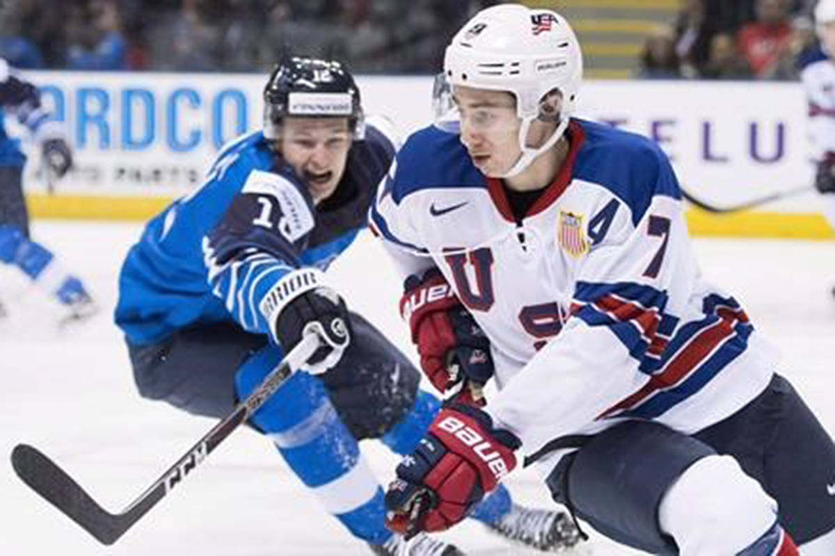 United States' Quinn Hughes (7) fights for control of the puck with Finland's Samuli Vainionpaa (12) during third period IIHF world junior hockey action in Victoria, Monday, Dec. 31, 2018. any of Quinn Hughes' new teammates on the Vancouver Canucks know all about the giant life transition the young defenceman is about to make.The 19-year-old signed a three-year entry-level deal with the organization on Sunday.THE CANADIAN PRESS/Jonathan Hayward