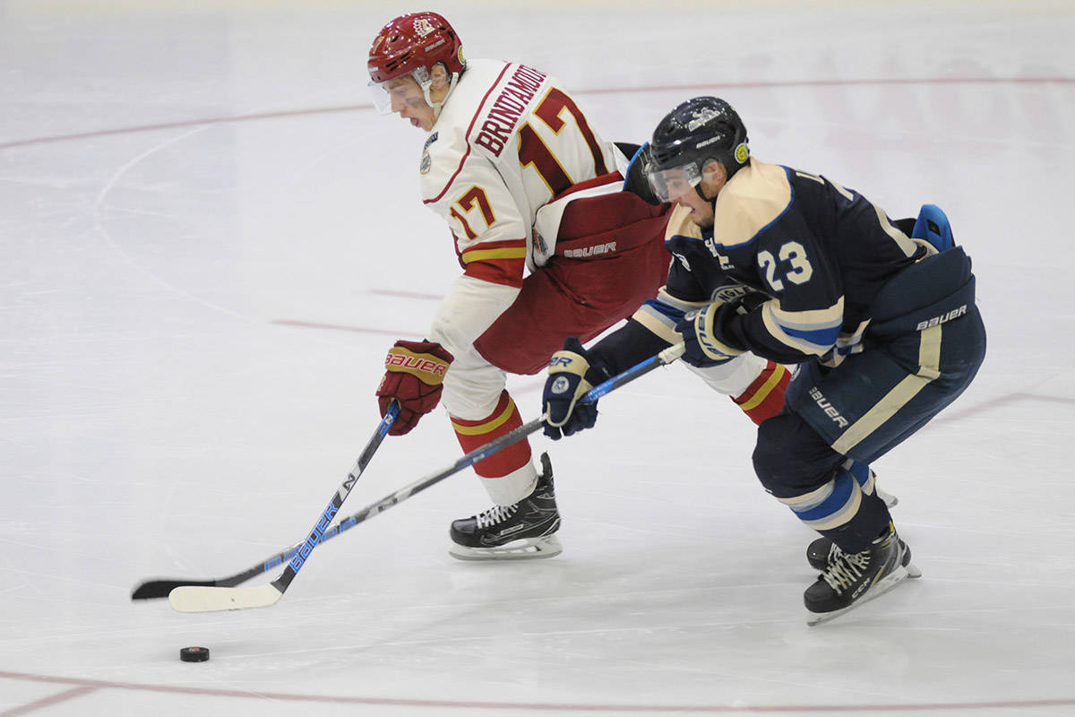 Skyler Brind'Amour of the Chilliwack Chiefs battles Jake Livingstone of the Langley Rivermen for the puck during Game 7 of the first round of the BCHL playoffs at Prospera Centre Sunday night. (Jenna Hauck/ The Progress)