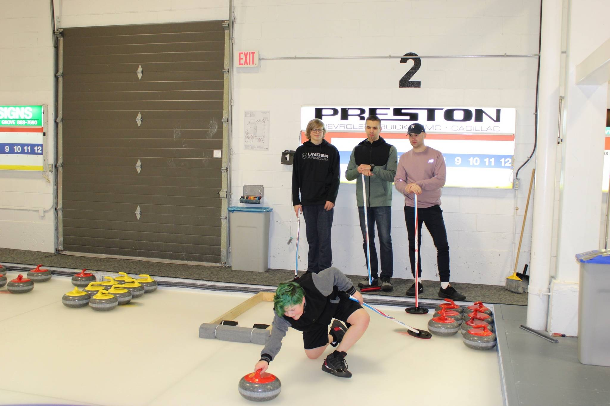 From left to right: Trenton, Caleb, Jason and Ryan from Big Brothers Big Sisters Langley enjoyed themselves at the Langley Curling Centre open house (Photo by Kieran O'Connor/Black Press Media).
