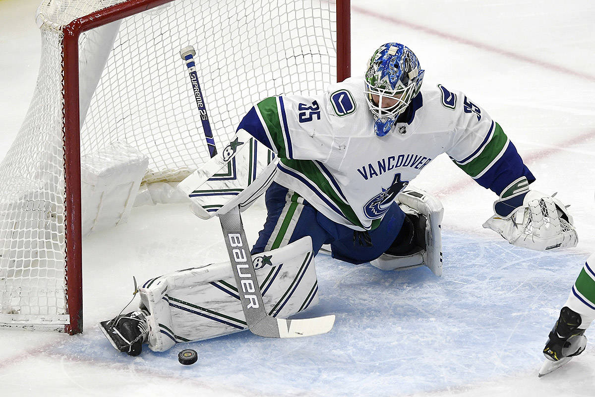 Vancouver Canucks goalie Thatcher Demko makes a save during the first period of an NHL hockey game against the Chicago Blackhawks, Monday, March 18, 2019, in Chicago. (AP Photo/Paul Beaty)