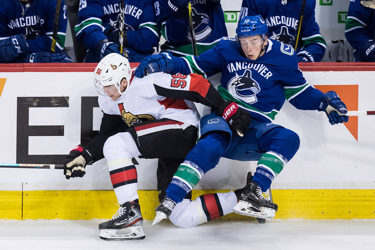 Ottawa Senators' Magnus Paajarvi, left, of Sweden, and Vancouver Canucks' Jake Virtanen collide during the second period of an NHL hockey game in Vancouver, on Wednesday March 20, 2019. THE CANADIAN PRESS/Darryl Dyck