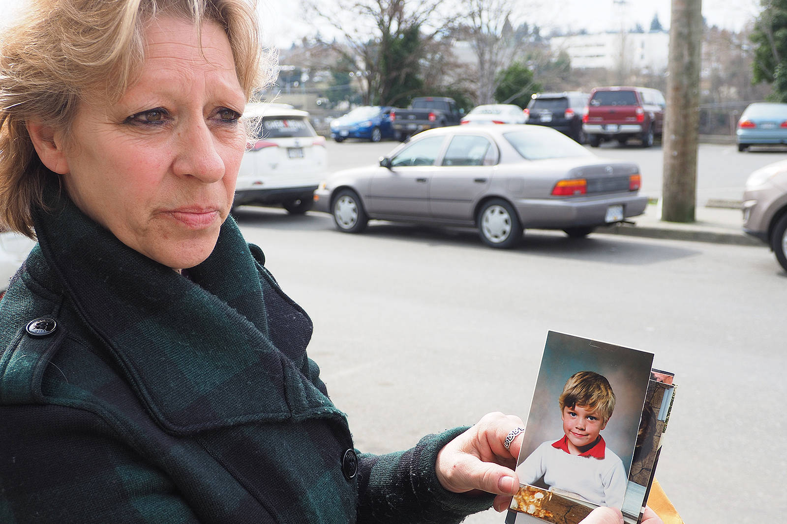 Wanda Campbell, mother of Andrew McLean, who was shot to death in the Howard Johnson Harbourside Hotel lobby in 2017, holds a photo of McLean when he was a child. Campbell submitted a victim's statement and watched video evidence of her son's killing during the opening day of sentencing proceedings for Brandon Tyler Woody, who pleaded guilty to second-degree murder Feb. 15. CHRIS BUSH/The News Bulletin