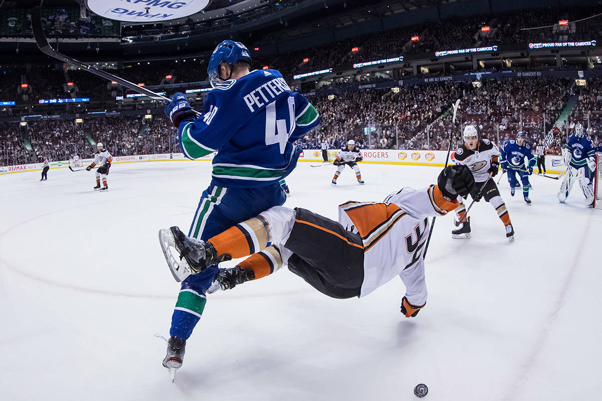 Vancouver Canucks' Elias Pettersson, left, of Sweden, and Anaheim Ducks' Sam Steel collide during the first period of an NHL hockey game in Vancouver, on Tuesday March 26, 2019. THE CANADIAN PRESS/Darryl Dyck