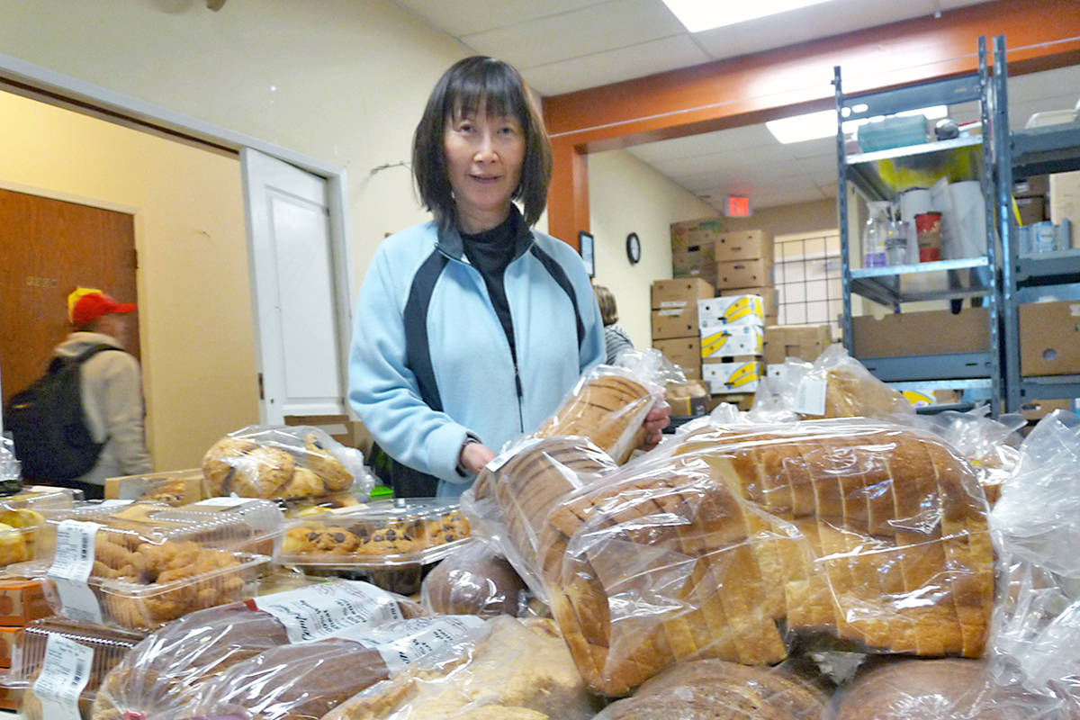 Volunteer Alice See was handing out baked goods at the regular Wednesday distribution by Sources Langley Food Bank. Dan Ferguson Langley Advance Times