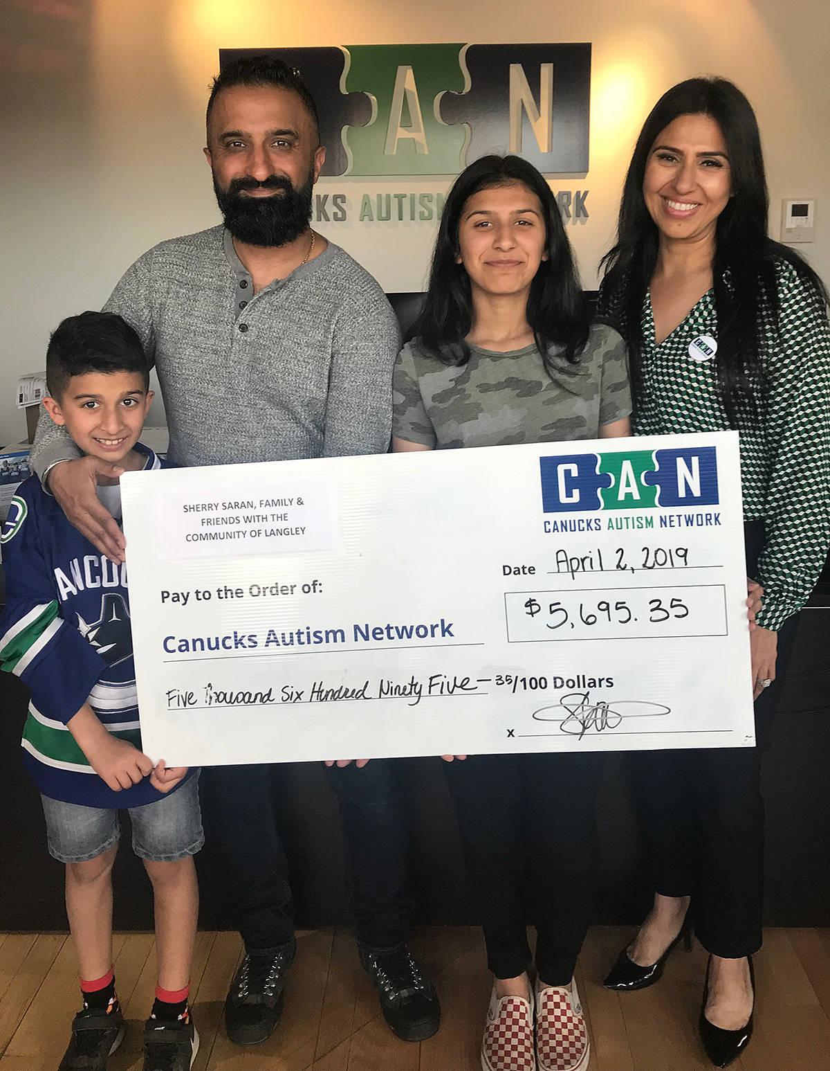 The Saran family took their money from their bottle and community fundraising drive into Canuck Autism Network Tuesday, on World Autism Awareness Day. They presented the organization with almost $5,700, and announced they'd be doing all over again next year.