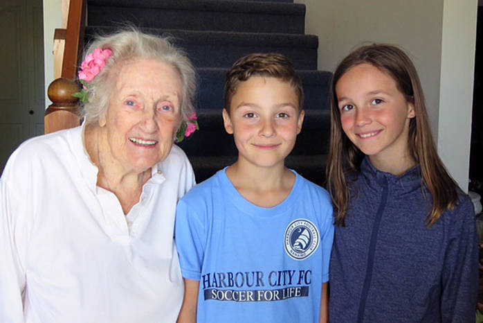 Lorraine Buchan, 90, is home recovering from injuries and grateful Noah Lutz, 8, and his sister Meghan, 11, happened by and heard her cries for help on their way to school. Buchan had fallen and was injured while taking out her trash bin March 14 and spent a cold night in the open doorway of her home hoping help would happen by. Photo submitted