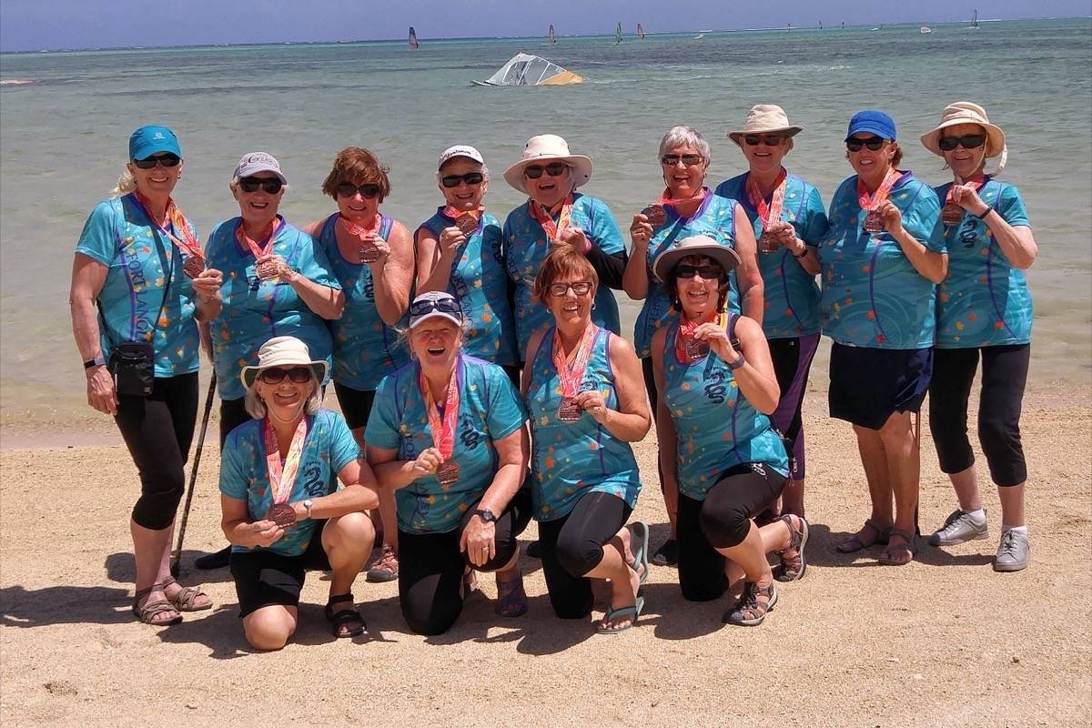 Dragon boaters paddle home with medals