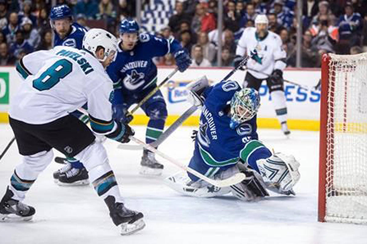 San Jose Sharks' Joe Pavelski (8) scores against Vancouver Canucks goalie Thatcher Demko during the first period of an NHL hockey game in Vancouver, on Tuesday April 2, 2019. THE CANADIAN PRESS/Darryl Dyck