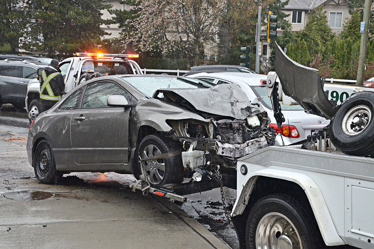 At least two vehicles were involved in the Wednesday morning collision – one was pushed onto the sidewalk. (Matthew Claxton/Langley Advance Times)