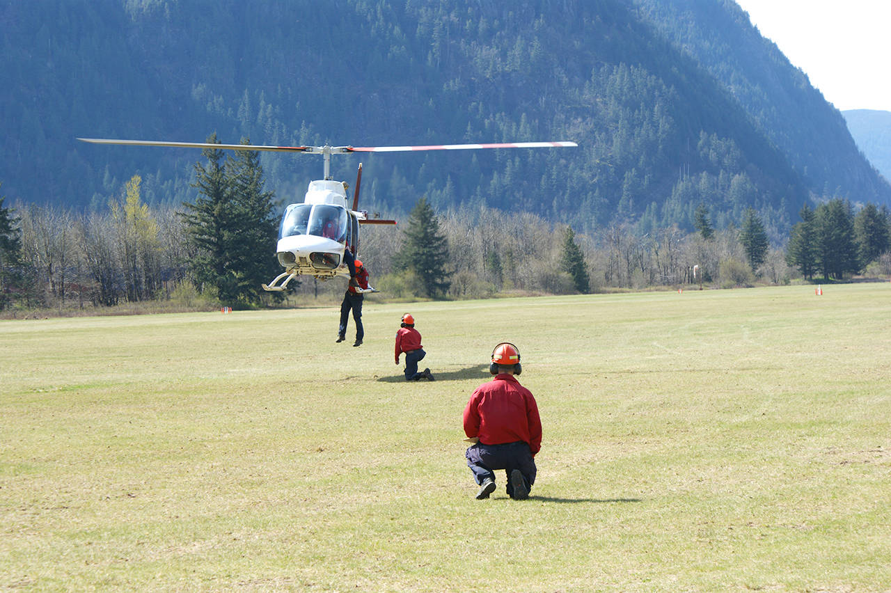 Kevin Cochrane of BC Wildfire Services looks on as firefighters practice their hovering heli-exit strategies.  Sarah Gawdin/Hope Standard