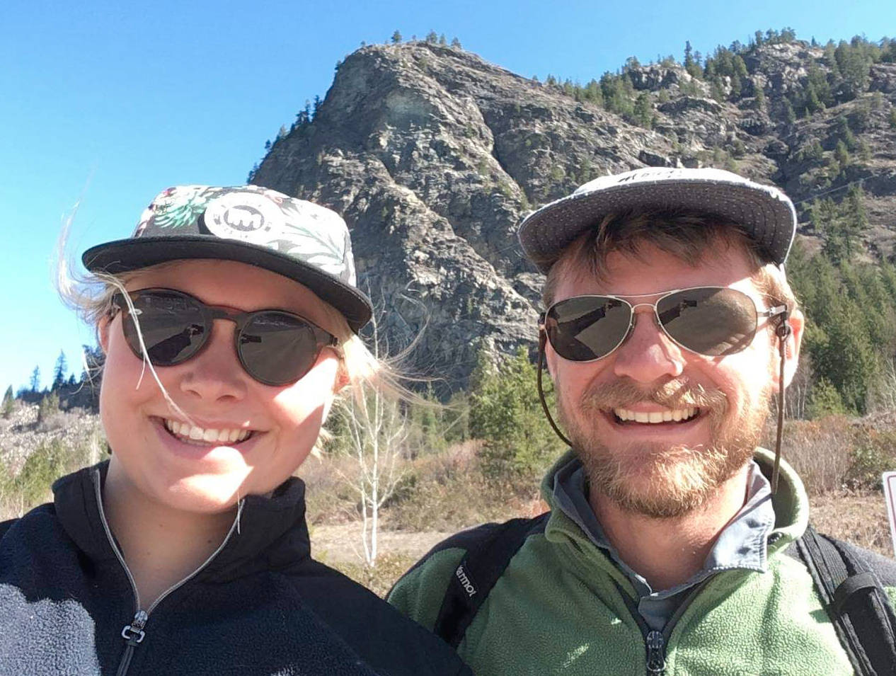 Hannah Stephan (left) and Jared Smith rescued a family pet from off of the Brilliant Bluffs, near Castlegar seen here in the background. (Submitted photo)