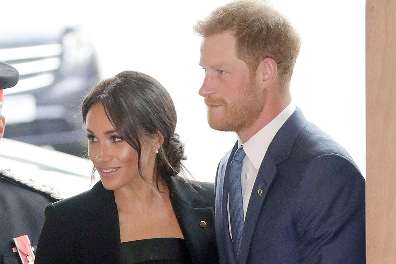 In this file photo dated Tuesday, Sept. 4, 2018, in his capacity as patron of the charity WellChild, Britain's Prince Harry and his wife Meghan, the Duchess of Sussex arrive for the annual WellChild awards in London. Kensington Palace announced Monday Oct. 15, 2018, that Prince Harry and his wife the Duchess of Sussex are expecting a child in spring 2019. (AP Photo/Matt Dunham, FILE)