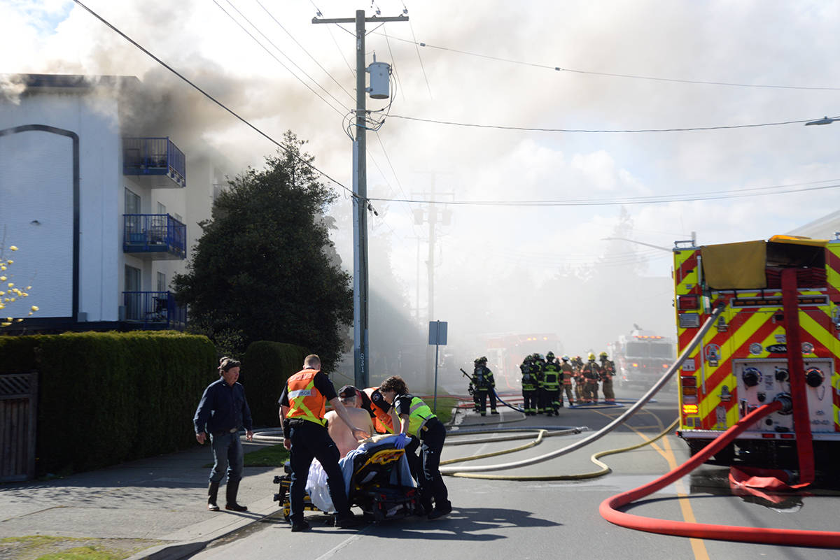 Four fire departments and more than 30 firefighters were on scene at a structure fire in Esquimalt on Sunday. It is believed that one person died in the fire. (Nina Grossman/News Staff)
