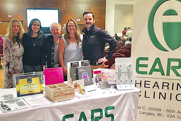 The team from Ears Hearing Clinics gather for a photo at a previous 60-Plus Lifestyle Expo in Langley. This year's free event happens May 10 at the Cascades Casino and Convention Centre.