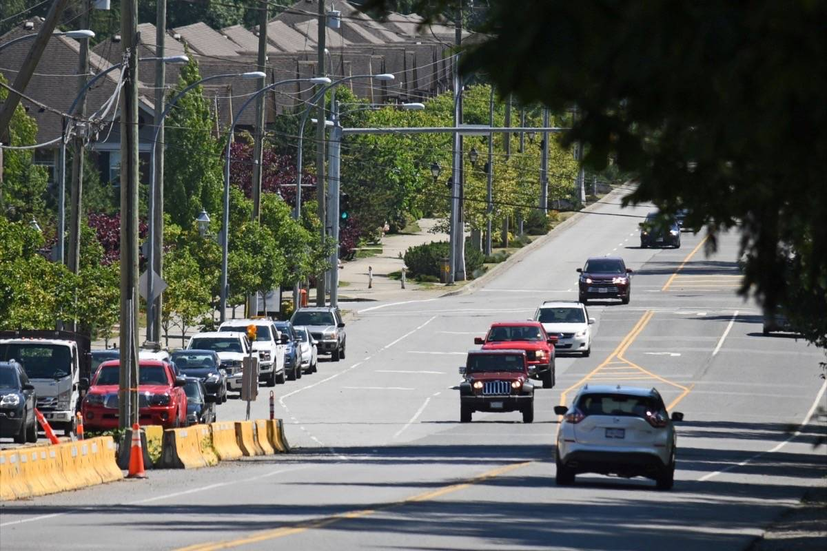Parts of 208th Street are widened, but others remain narrow as development proceeds at different paces on different lots (Langley Advance Times files)