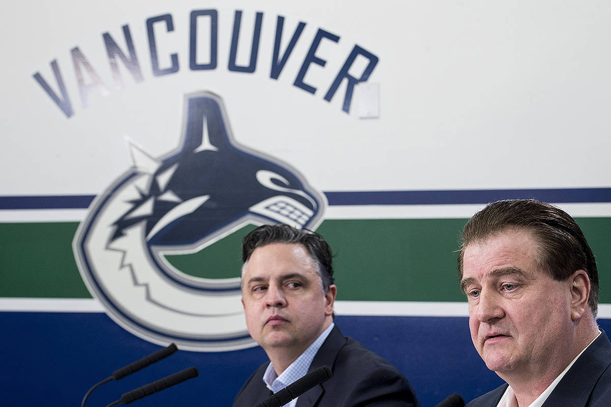 Vancouver Canucks general manager Jim Benning, right, and head coach Travis Green pause for a moment during a news conference at Rogers Arena in Vancouver on Monday, April 8, 2019. The Canucks finished their season this past weekend failing to make the 2019 playoffs. THE CANADIAN PRESS/Jonathan Hayward