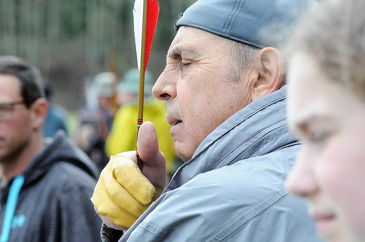 An archer checks the condition of an arrow. Dan Ferguson Langley Advance Times