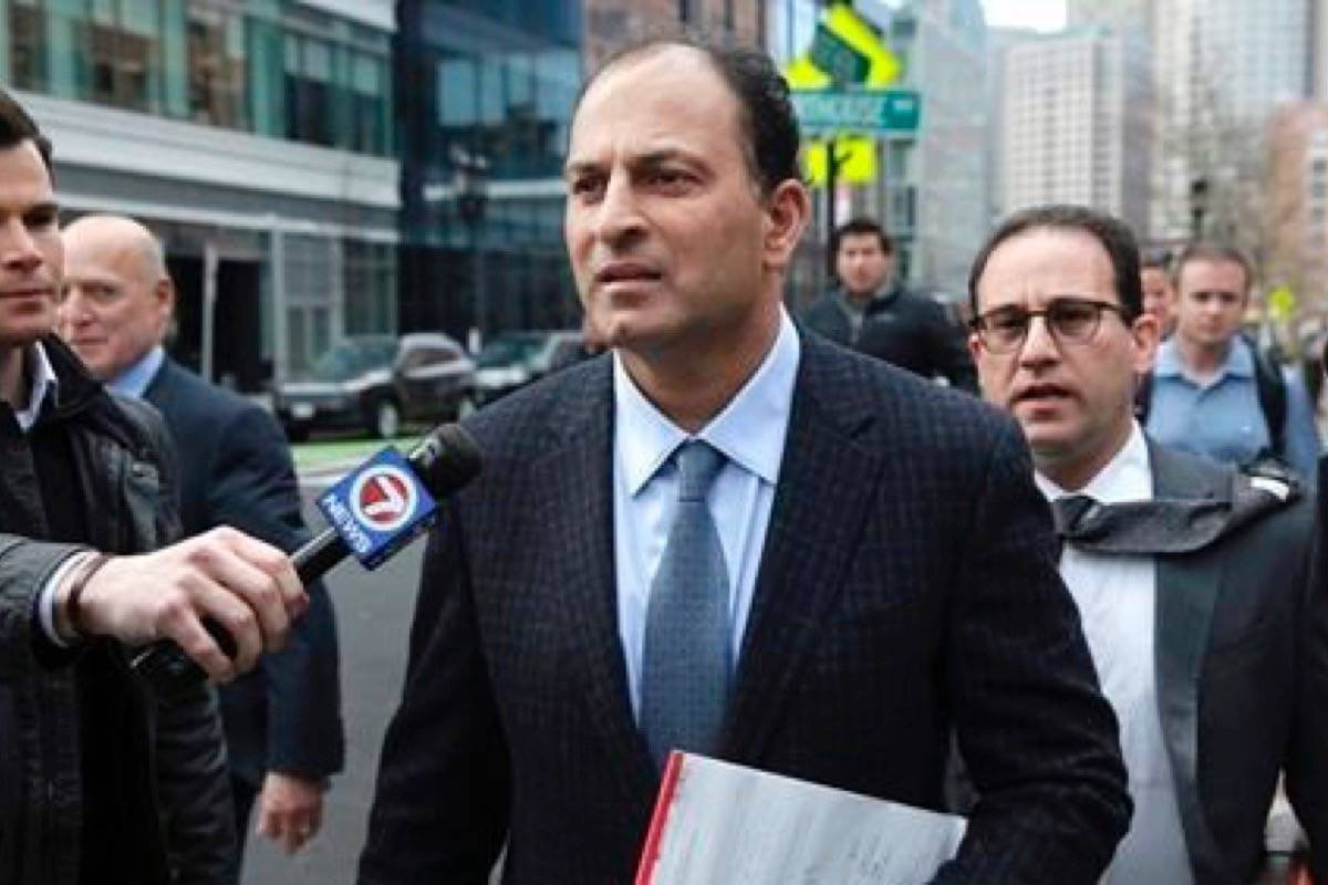David Sidoo, of Vancouver leaves following his federal court hearing Friday, March 15, 2019, in Boston. Sidoo pleaded not guilty to charges as part of a wide-ranging college admissions bribery scandal. (Jonathan Wiggs/The Boston Globe via AP)