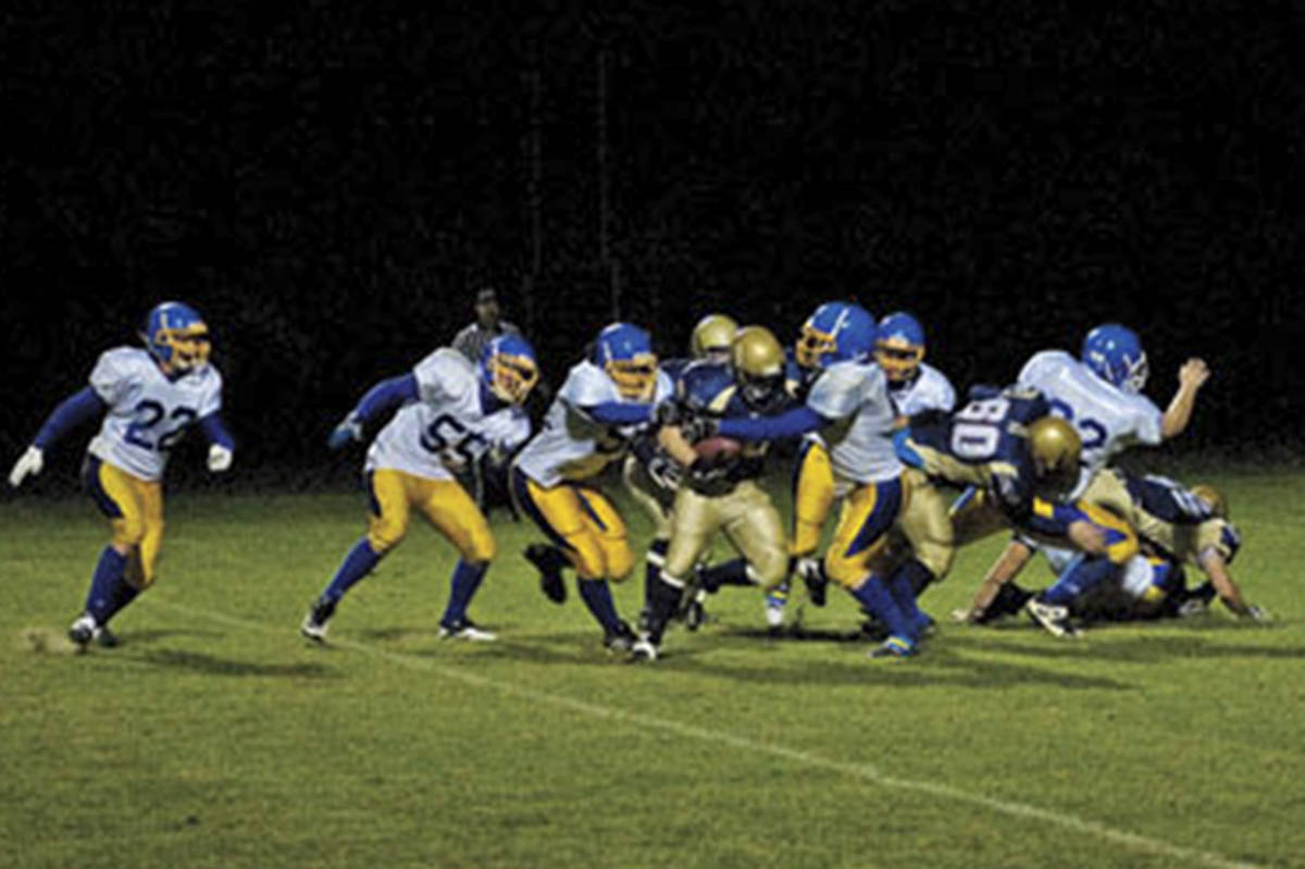 Matrix Gathergood carries the ball during a Salmon Arm Secondary Varsity Golds game in October of 2011. (File photo)