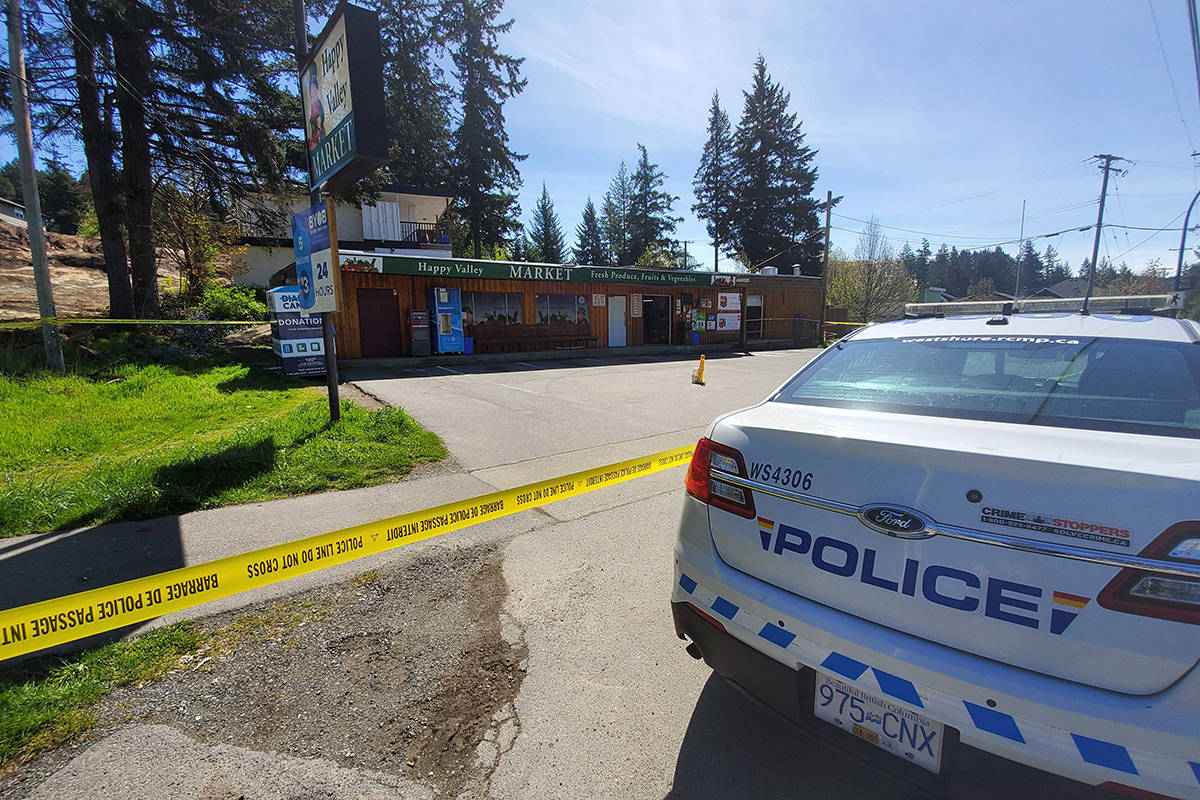 The Happy Valley Market is cordoned off by police tape after reports of a shooting late Tuesday morning. (Swikar Oli/News Staff)