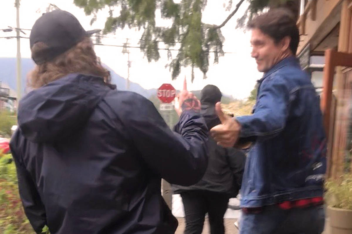 "Friends of Clayoquot Sound campaigner Jeh Custerra greets Canadian Prime Minister Justin Trudeau outside a restaurant in Tofino. Custerra said he held up one finger to represent ""One earth, one chance."" (Photo - Friends of Clayoquot Sound)"