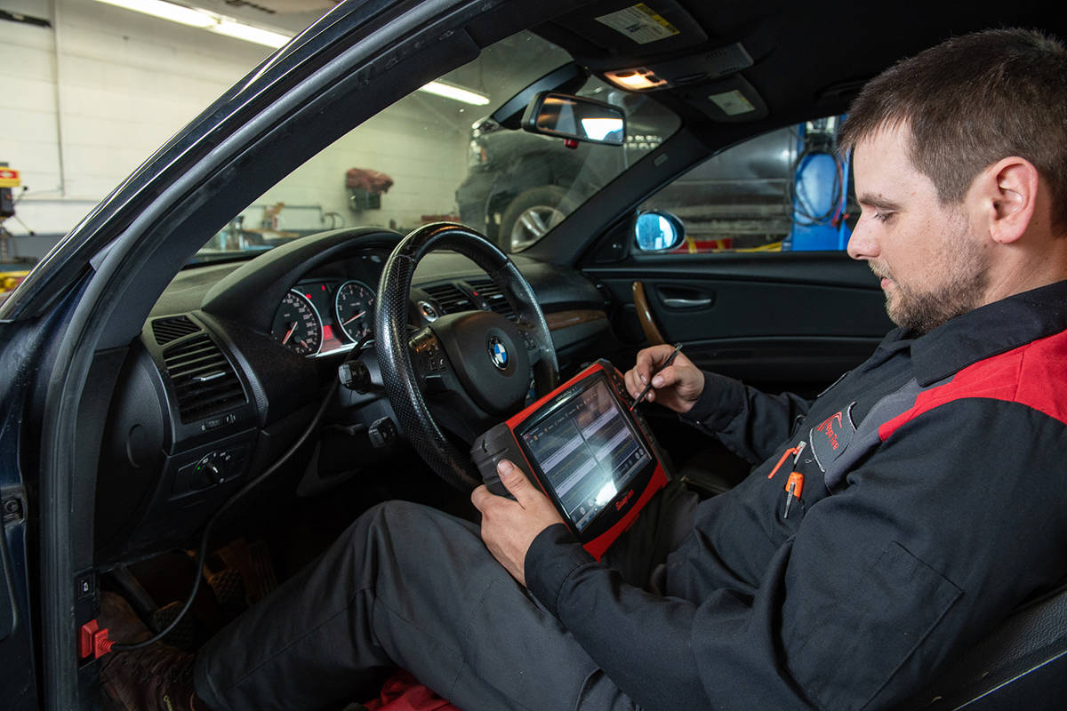 Technicians like Nic Nelson at Foreman's Integra Tire Auto Centre in Langley use state-of-the-art technologies when diagnosing and working on your vehicle. Photo by Dennis Ducklow