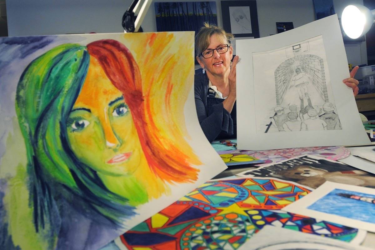 (Colleen Flanagan/THE NEWS)                                Philippa Glossop with some of the artwork that was created by students with anxiety.