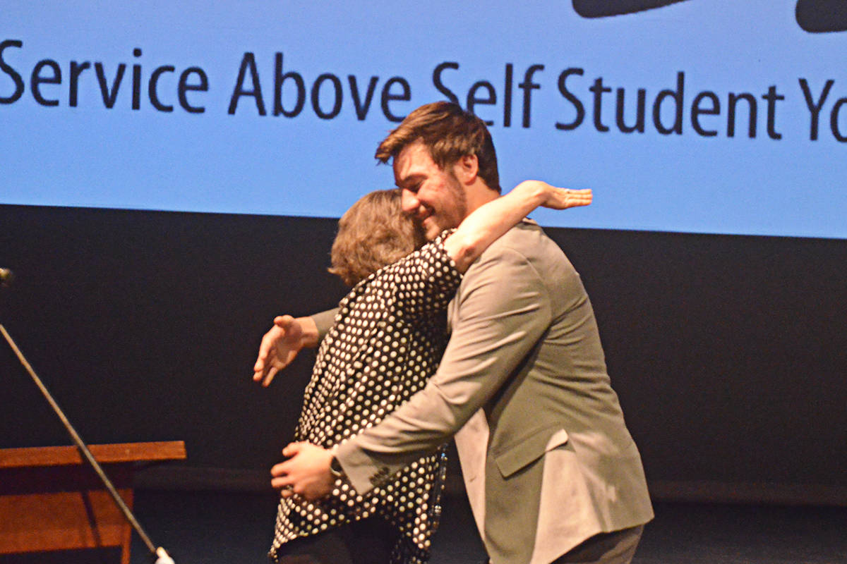 Brady Lumsden accepts his Sassy Award and a hug from presenter Susan Cairns at the Thursday night SASSY Awards. (Matthew Claxton/Langley Advance Times)