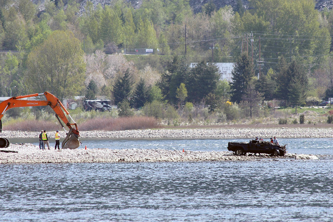 The body of a Castlegar man was recovered after his truck was pulled from the Kootenay River, almost a year after it plunged off a Castlegar Road. (Photos: Betsy Kline)