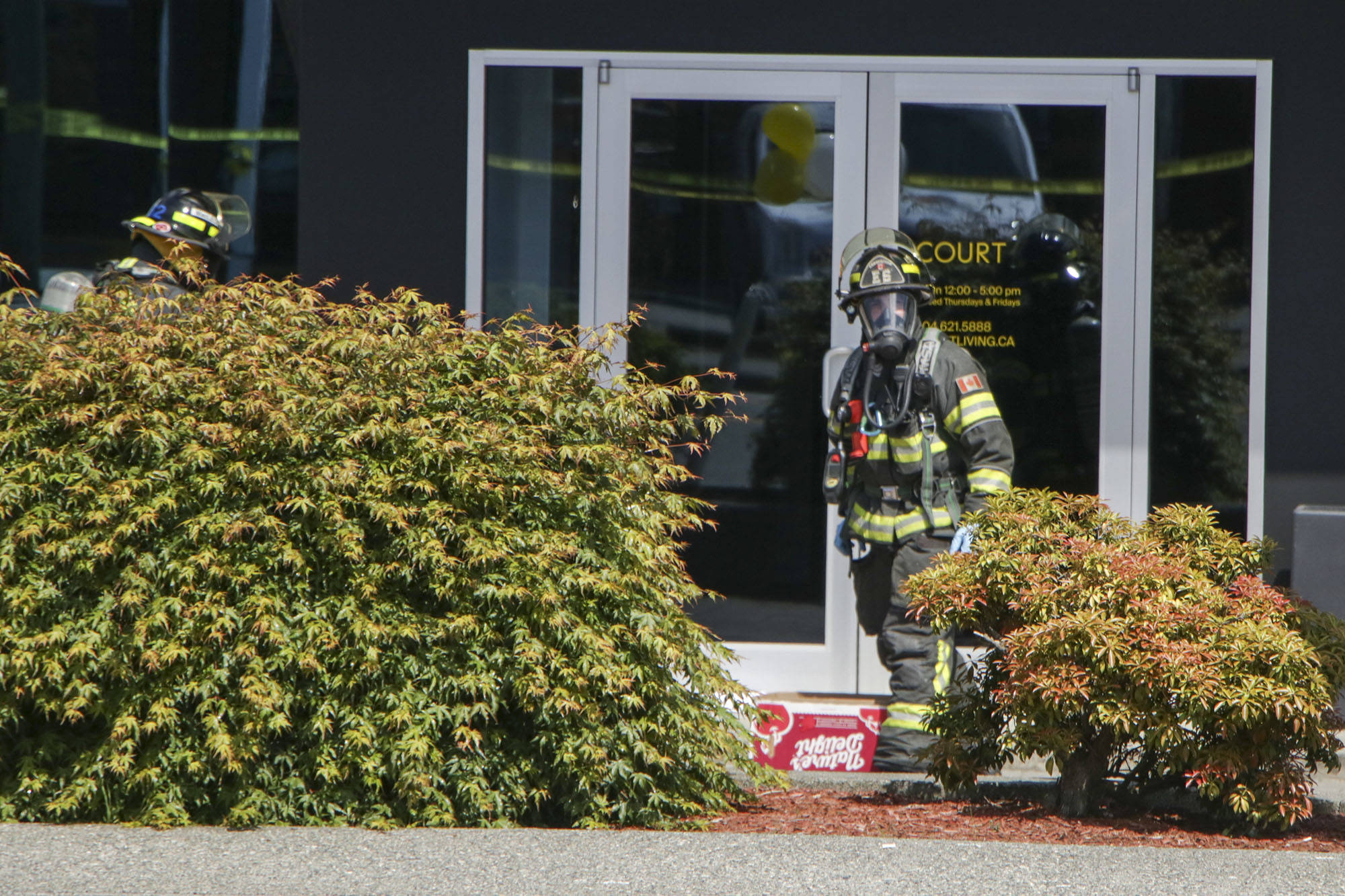 Employees recover after breathing fumes from package sent to offices of B.C. development