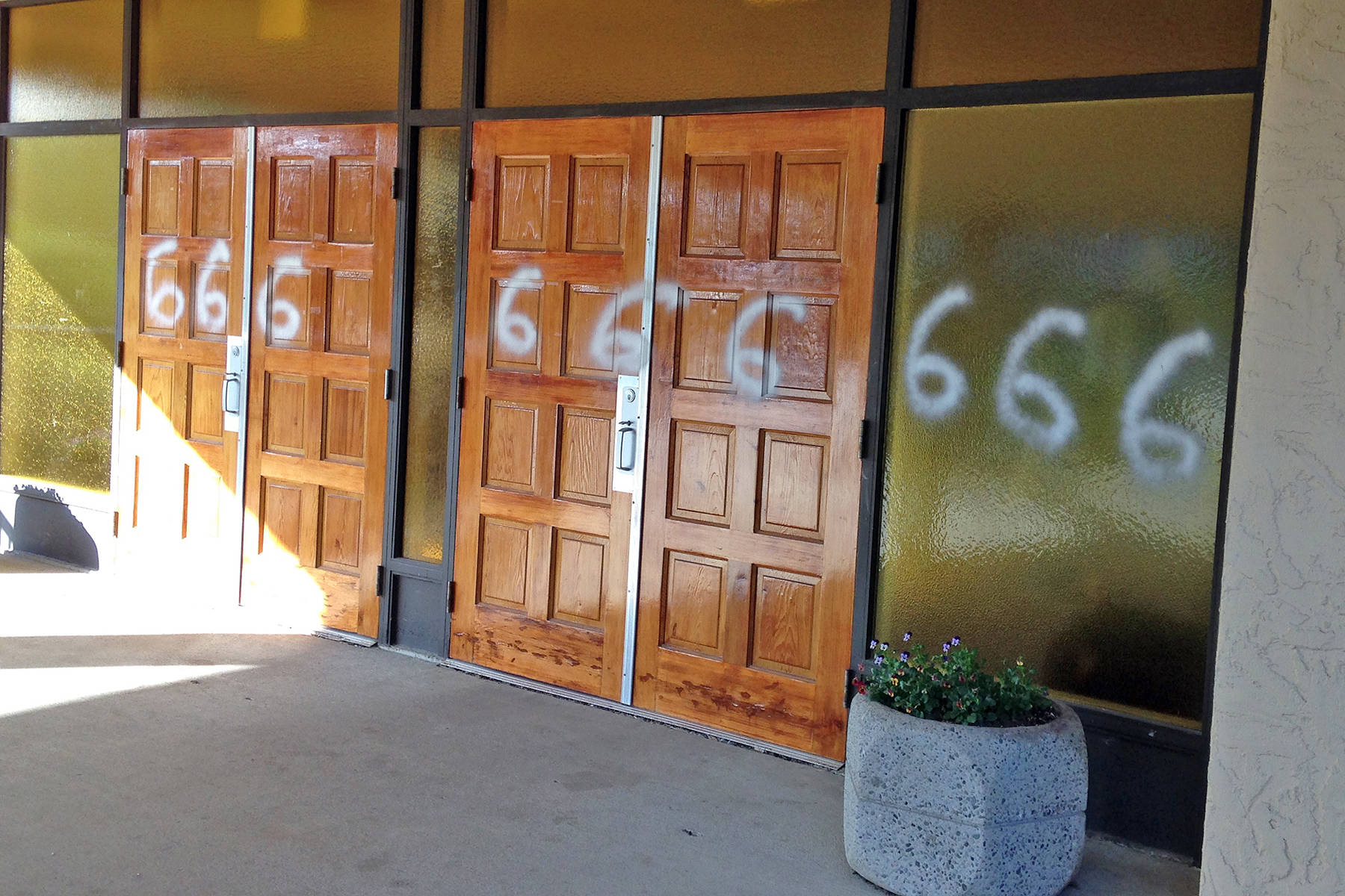 Mission's St. Joseph's Catholic Parish on 7th Avenue was struck by vandals on the weekend. Someone painted ^666 and Judge Me all over the church. / Submitted Photos