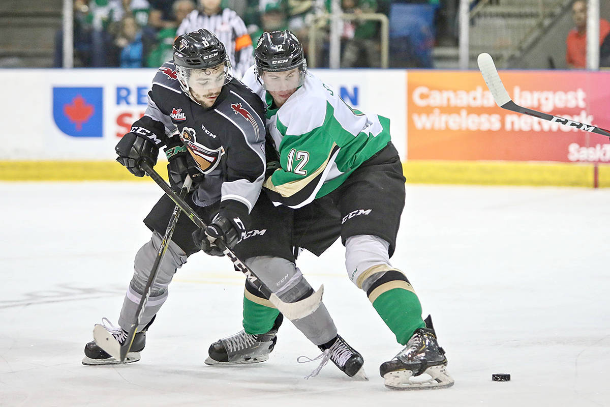 Giants forward Tristen Nielsen tussled with a Raider Monday night. The Giants fell in overtime to the Prince Albert in Game 7, the Raiders taking the Chynoweth Cup 3-2. (Lucas Chudleigh/Special to Black Press)