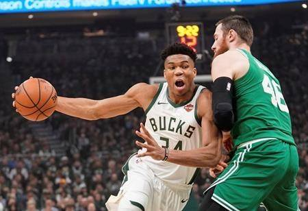 Milwaukee Bucks' Giannis Antetokounmpo drives past Boston Celtics' Aron Baynes during the first half of Game 5 of a second round NBA basketball playoff series Wednesday, May 8, 2019, in Milwaukee. (AP Photo/Morry Gash)