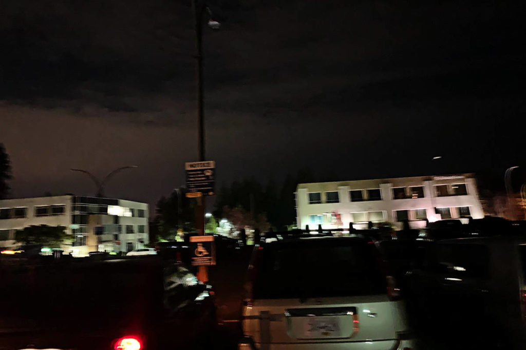 Buildings near Langley Memorial Hospital were lit up, but the parking lots were dark on a recent night as the lights went out. (Photo submitted)