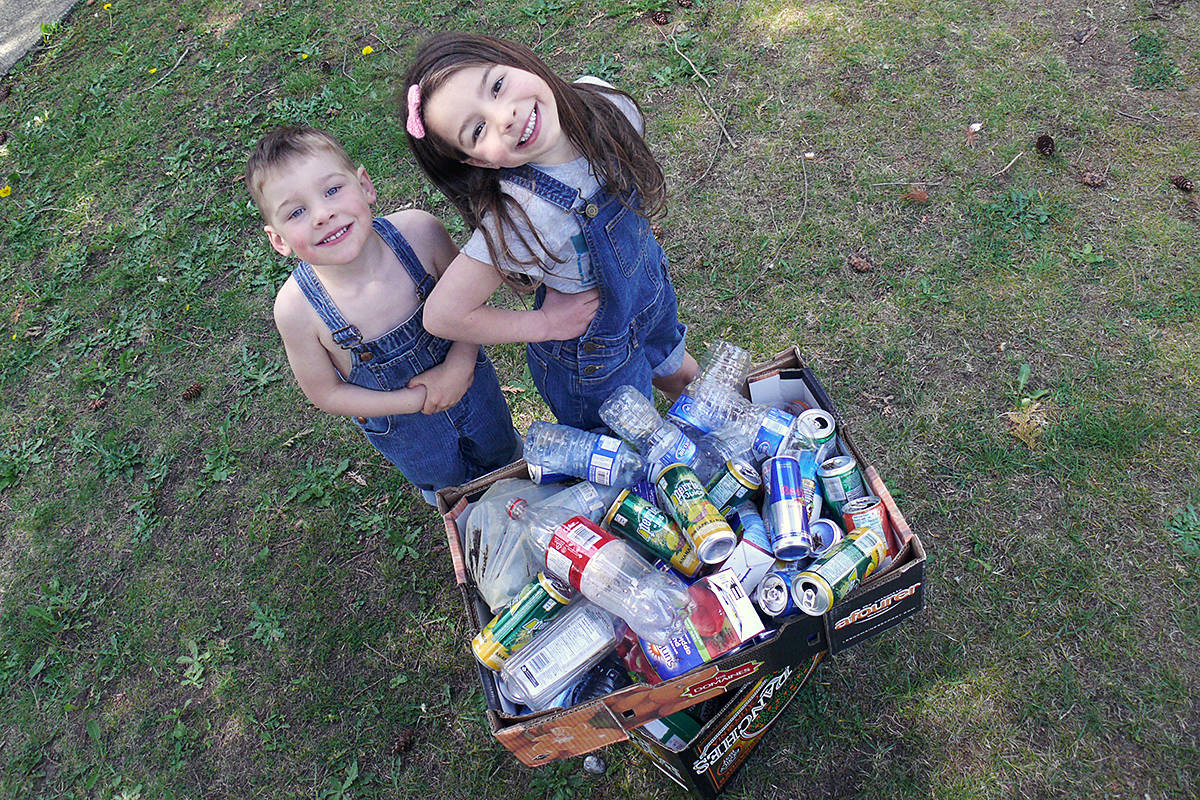 Barrett and Paisley with some of their more recent collected bottles and cans. Dan Ferguson Langley Advance Times