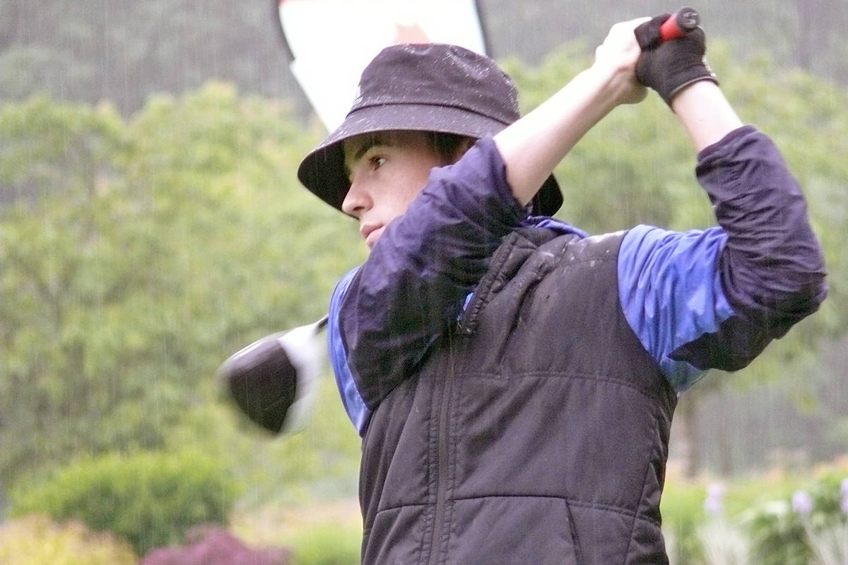 Riley Geiger of Langley teed off in the pouring rain at the start of the MJT Lindsay Kenney Classic at Pagoda Ridge golf club. He finished sixth. Dan Ferguson Langley Advance Times