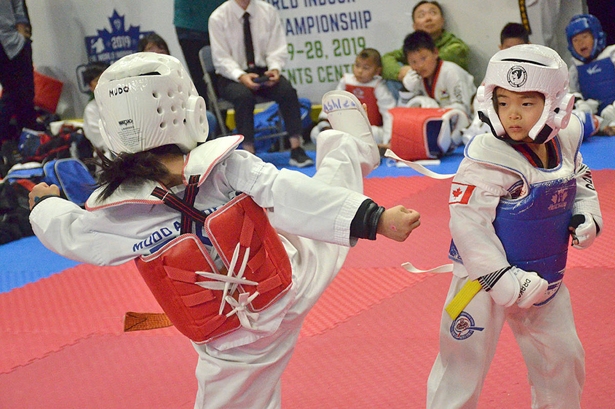 Full-contact sparring at the BC Korean Consul General Cup Tournament and Taekwondo Festival at the Langley events Centre. Photo by Gary Ahuja/Langley Events Centre