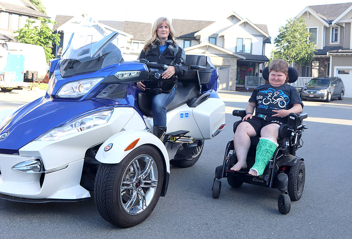 Doug Penner will swap out his power wheelchair for the back seat of his mother's Spyder motorcycle during this Sunday's 13th annual Ride for Doug charity motorcycle trek. (Cam Penner photo)