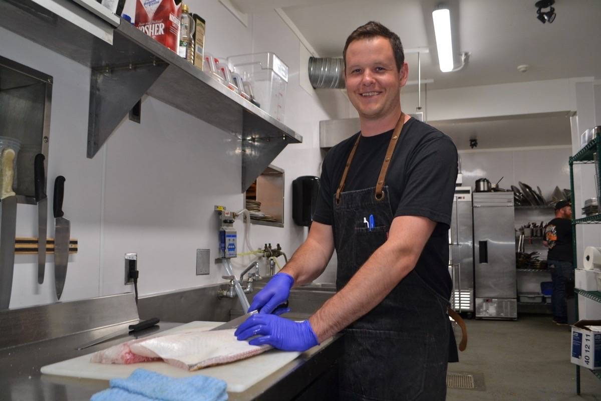 Paul Moran, Tofino Resort + Marina's executive chef and the newly crowned Top Chef Canada, fillets a halibut for dinner guests at 1909 Kitchen last week. Moran served the premier whitefish with freshly foraged morel mushrooms and seaweed. (Nora O'Malley / Westerly News)