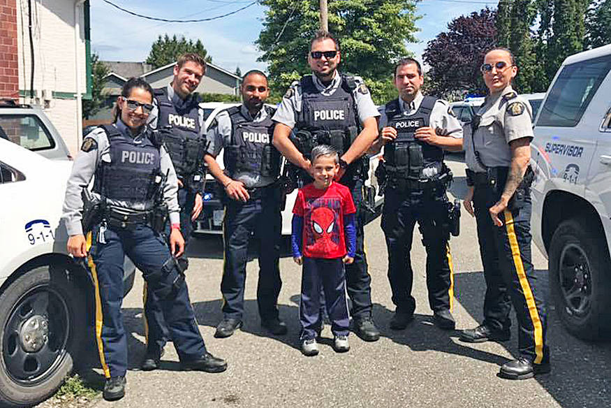 Six members of the Mission RCMP came to help six-year-old Austin Hall-Waters celebrate his birthday on Sunday. / FaceBook Photo