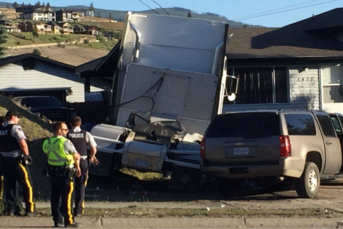 Officer injured after police SUV crashes into semi-trailer in Kelowna