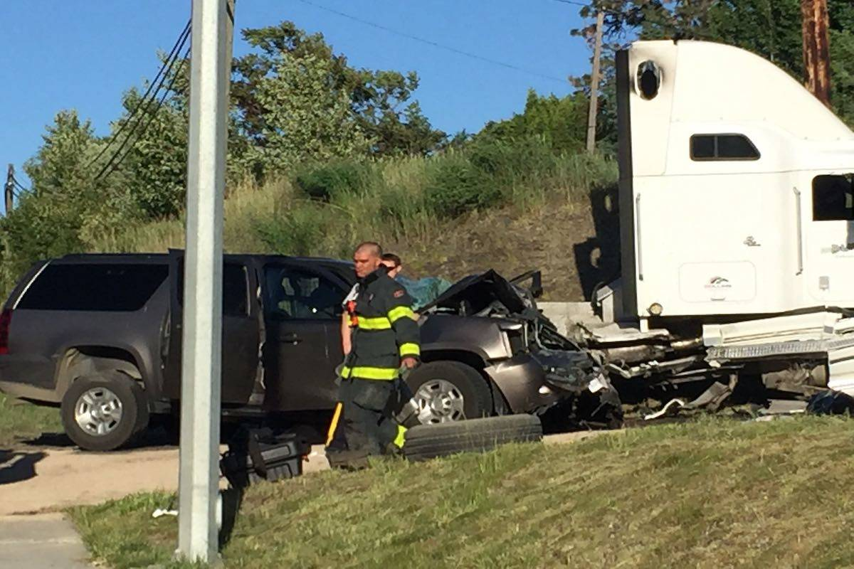 Photo: Barry Gerding. Police on scene of a crash on Highway 33 in Kelowna.