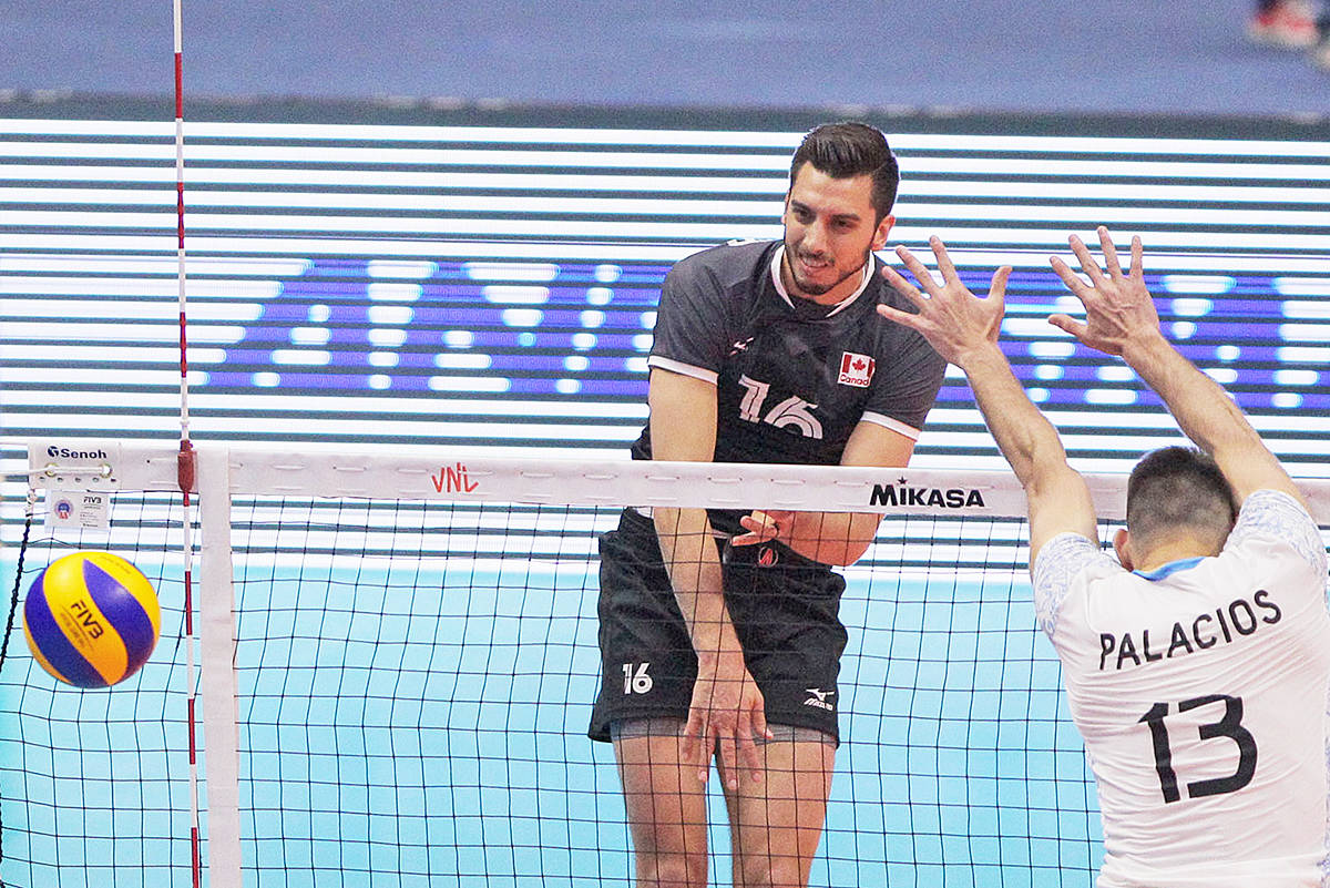 Ryan Sclater spikes the ball against Argentina. The former TWU player was top scorer in the Team Canada win. Photo courtesy Fédération Internationale de Volleyball (FIVB)