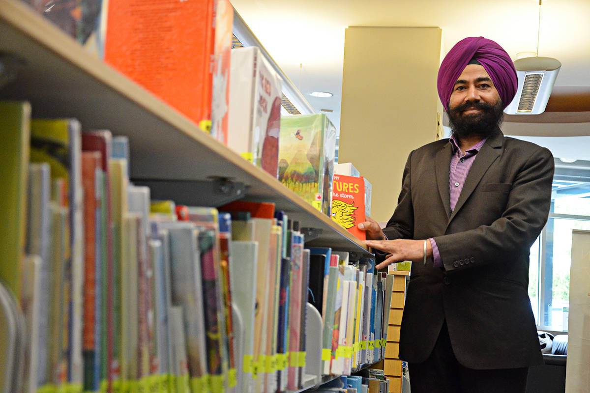 Dr. Sarwan Randhawa is a community librarian at Muriel Arnason Library, one of the youngest facilities in the Fraser Valley Regional Library system. (Matthew Claxton/Langley Advance)