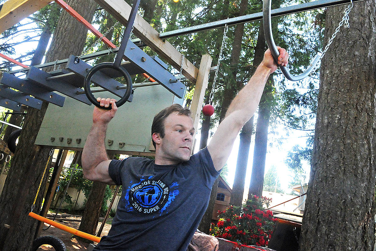 """Brookswood resident Tristan Kasmer works out on his home-made obstacle course. Inspired by the television show """"American Ninja Warrior"""" it has taken over his backyard and now is the site of the annual """"Backyard Ninja"""" competition, now in its second year. Dan Ferguson Langley Advance Times"""